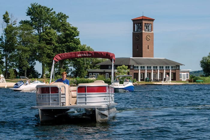 Pontoon boat on CHautauqua Lake in front of Bell Tower