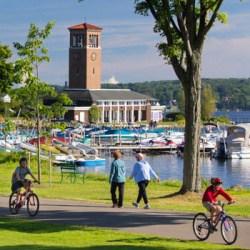 People walking and riding bikes along the lake